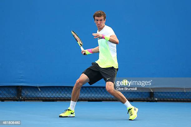Andrey Kuznetsov of Russia plays a forehand in his first round match against Albert Ramos of Spain during day two of the 2015 Australian Open at...