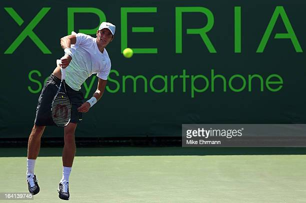 Andrey Kuznetsov of Russia plays a match against Victor Hanescu of Romania during Day 3 of the Sony Open at Crandon Park Tennis Center on March 20,...