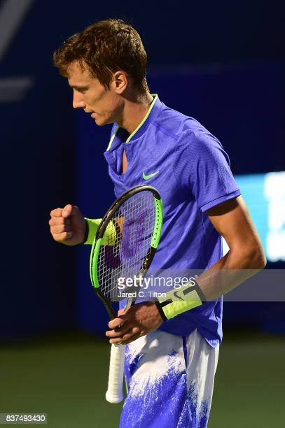 Andrey Kuznetsov of Russia reacts after a point against John Isner during the fourth day of the Winston-Salem Open at Wake Forest University on...