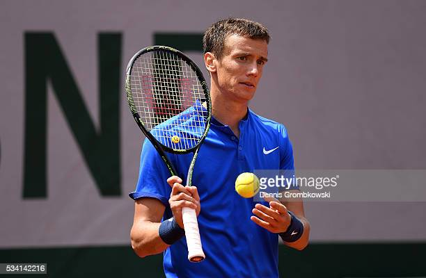 Andrey Kuznetsov of Russia reacts during the Men's Singles second round match against Kei Nishikori of Japan at Roland Garros on May 25, 2016 in...