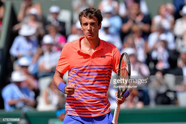 Andrey Kuznetsov of Russia reacts during the men's singles third round game against Rafael Nadal of Spain at Roland Garros on May 30, 2015 in Paris,...