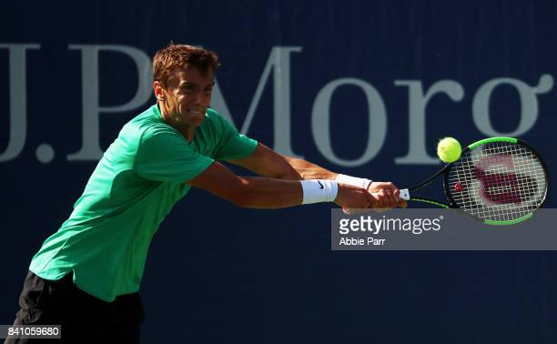 Andrey Kuznetsov of Russia returns a shot against Feliciano Lopez of Spain during their first round Men's Singles match on Day Three of the 2017 US...