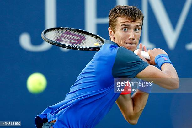 Andrey Kuznetsov of Russia returns a shot against Fernando Verdasco of Spain on Day Four of the 2014 US Open at the USTA Billie Jean King National...