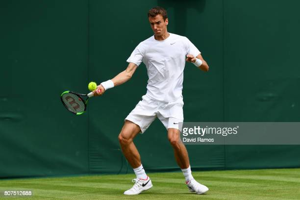 Andrey Kuznetsov of Russia returns a shot during the gentlemen's singles first round match against Andrey Kuznetsov of Russia on day one of the...