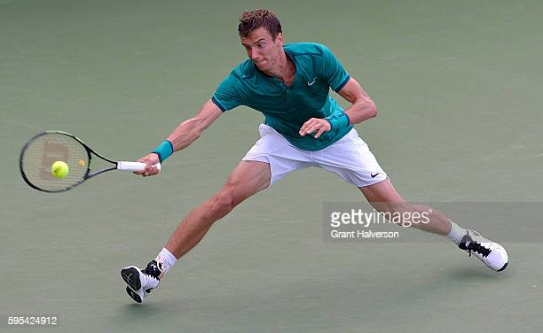 Andrey Kuznetsov of Russia returns a shot to Pablo Carreno Busta of Spain during the Winston-Salem Open at Wake Forest University on August 25, 2016...