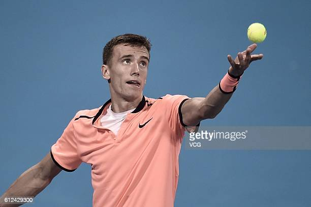 Andrey Kuznetsov of Russia serves against Konstantin Kravchuk of Russia during the Men's singles first round match on day four of the 2016 China Open...