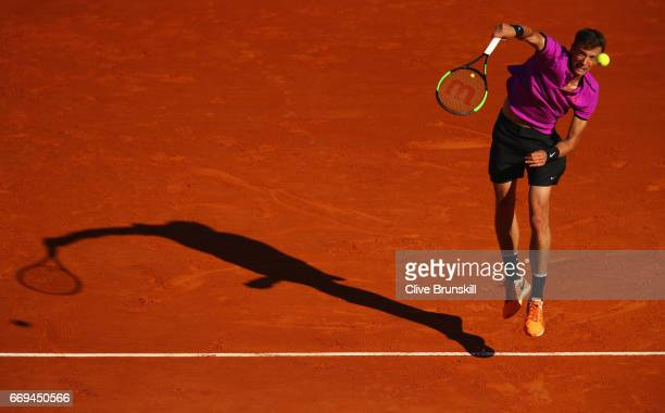Andrey Kuznetsov of Russia serves against Tomas Berdych of the Czech Republic in their first round match on day two of the Monte Carlo Rolex Masters...