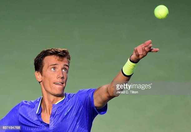 Andrey Kuznetsov of Russia serves to John Isner during the fourth day of the Winston-Salem Open at Wake Forest University on August 22, 2017 in...