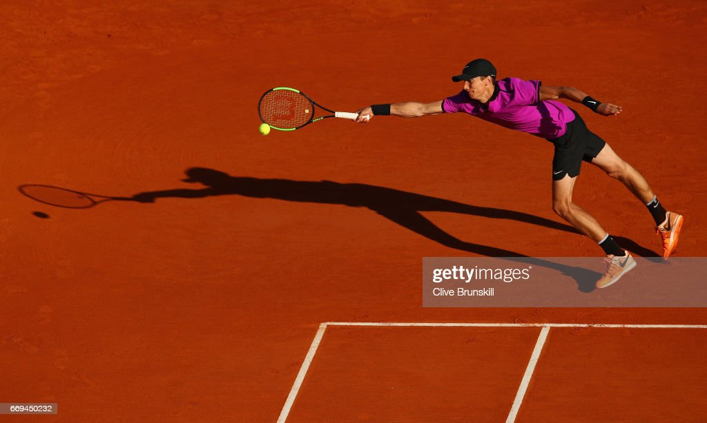 Andrey Kuznetsov of Russia stretches to play a forehand against Tomas Berdych of the Czech Republic in their first round match on day two of the Monte Carlo Rolex Masters at Monte-Carlo Sporting Club on April 17, 2017 in Monte-Carlo, Monaco.