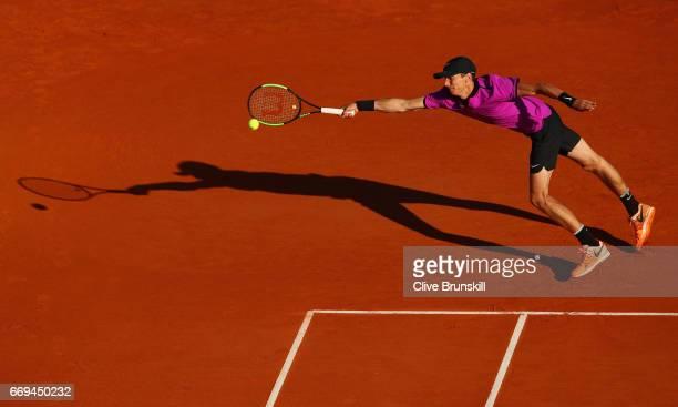 Andrey Kuznetsov of Russia stretches to play a forehand against Tomas Berdych of the Czech Republic in their first round match on day two of the...
