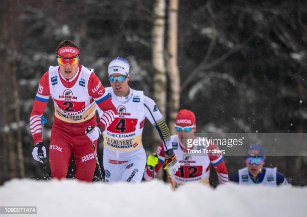 Andrey Larkov of Russia Evgenly Belov of Russia Calle Halfvarsson of Sweden during FIS WC Men 4 x 75 km Relay Classic/ Free on January 27 2019 in...