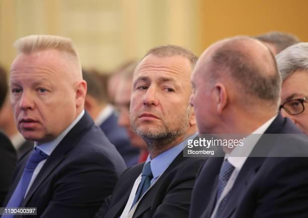 Andrey Melnichenko billionaire and owner of EuroChem Group AG center looks towards Dmitry Pumpyansky billionaire and owner of TMK PAO in the audience...