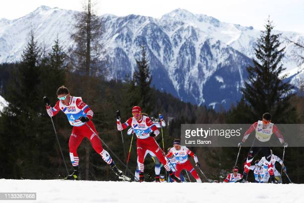 Andrey Melnichenko of Russia and Alexey Chervotkin of Russia compete in the Men's Cross Country 50k race during the FIS Nordic World Ski...