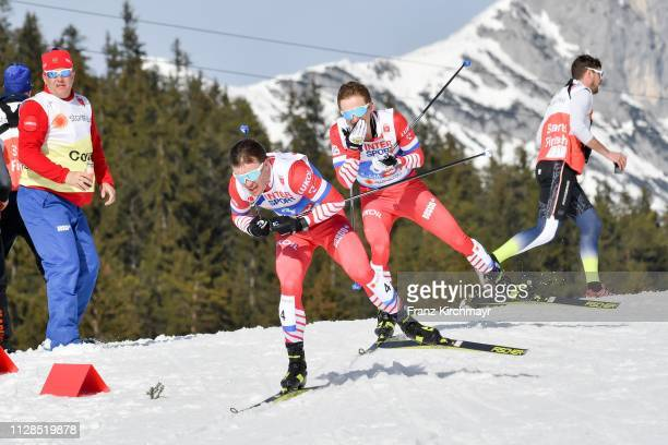 Andrey Melnichenko of Russia and Denis Spitsov of Russia during the Men's Cross Country Mass Start at the FIS Nordic World Ski Championships at...