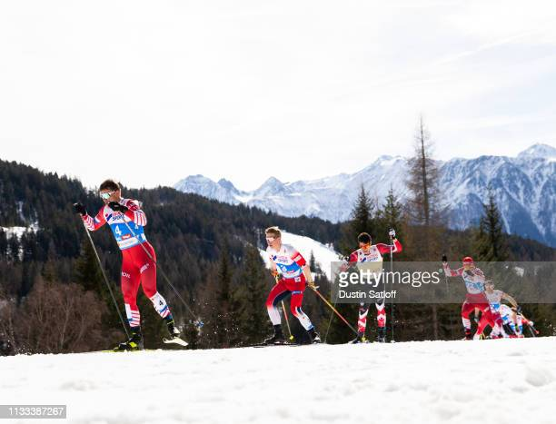 Andrey Melnichenko of Russia and Simen Hegstad Krueger of Norway competes in the Men's 50km Cross Country mass start during the FIS Nordic World Ski...