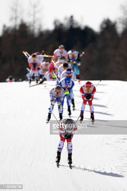 Andrey Melnichenko of Russia leads the field in the Men's Cross Country 50k race during the FIS Nordic World Ski Championships on March 03 2019 in...