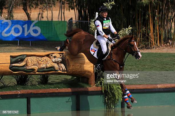 Andrey Mitin of Russia riding Gurza clears a jump during the Cross Country Eventing on Day 3 of the Rio 2016 Olympic Games at the Olympic Equestrian...