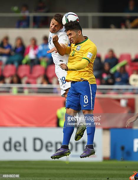 Andrey of Brazil and Herbie Kane of England challenge each other for the ball during the FIFA U17 World Cup Group B match between England and Brazil...