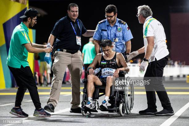 Andrey Petrov of Uzbekistan is taken away in a wheelchair after the Men's Marathon during day nine of 17th IAAF World Athletics Championships Doha...