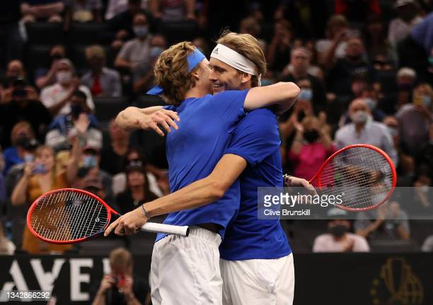 Andrey Rublev and Alexander Zverev of Team Europe react to match point against Denis Shapovalov and Reilly Opelka of Team World during the ninth...