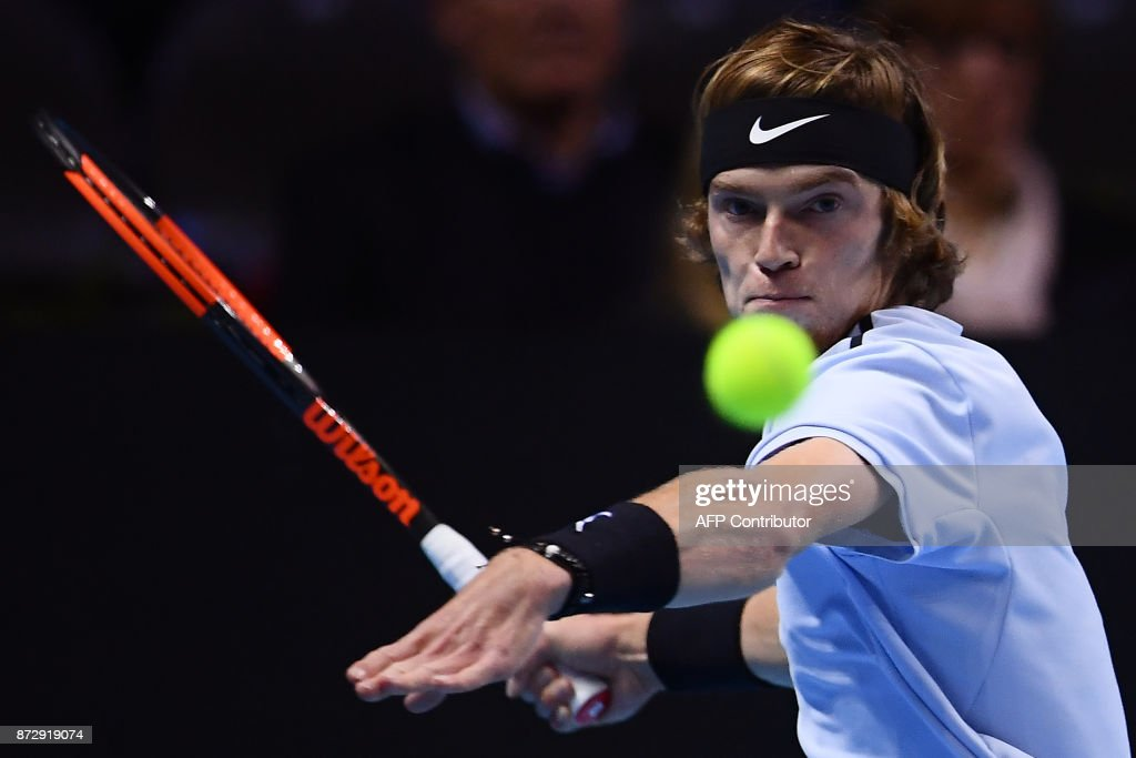 Andrey Rublev from Russia returns the ball to Hyeon Chung from South Korea in their men's singles tennis final match during the first edition of the Next Generation ATP Finals in Milan on November 11, 2017, an annual men's youth tennis tournament organized by the Italian Tennis Federation and the Italian Olympic Committee. /