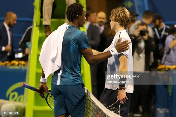 Andrey Rublev of Russia and Gael Monfils of France congratulate each other after the Qatar ExxonMobil Open 2018 Tennis Tournament Men's Final match...