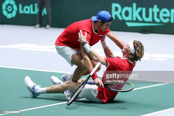 Andrey Rublev of Russia and team mate Karen Khachanov celebrate winning match point in their quarter final doubles match against Serbia on Day Five...