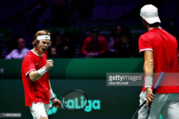 Andrey Rublev of Russia celebrates a point with teammate Karen Khachanov of Russia in the semi final doubles match between Russia and Canada during...