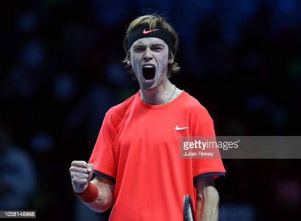 Andrey Rublev of Russia celebrates defeating Taylor Fritz of USA in the group stages during Day One of the Next Gen ATP Finals at Fiera Milano Rho on...