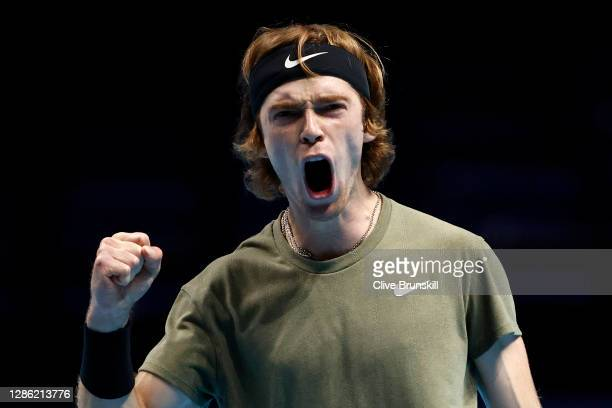Andrey Rublev of Russia celebrates winning the first set during his singles match against Stefanos Tsitsipas of Greece during day three of the Nitto...
