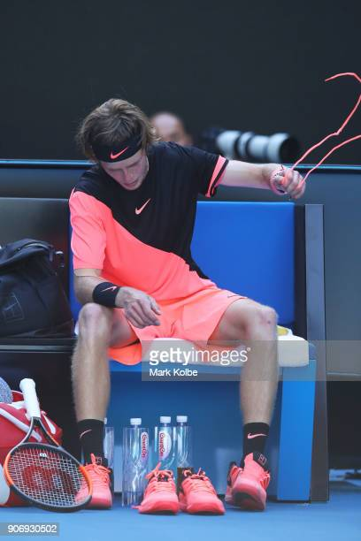 Andrey Rublev of Russia changes shoes between games in his third round match against Grigor Dimitrov of Bulgaria on day five of the 2018 Australian...