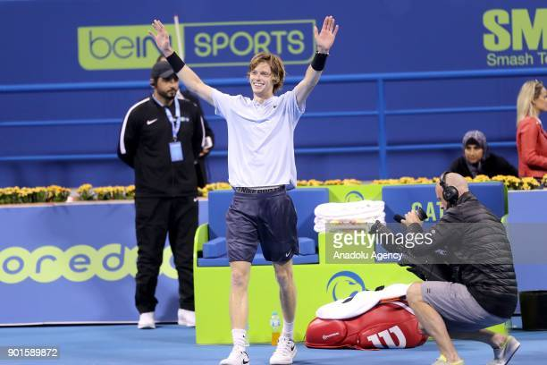 Andrey Rublev of Russia greets the crowd as he celebrates after his victory over Guido Pella of Argentina during the Qatar ExxonMobil Open Tennis...