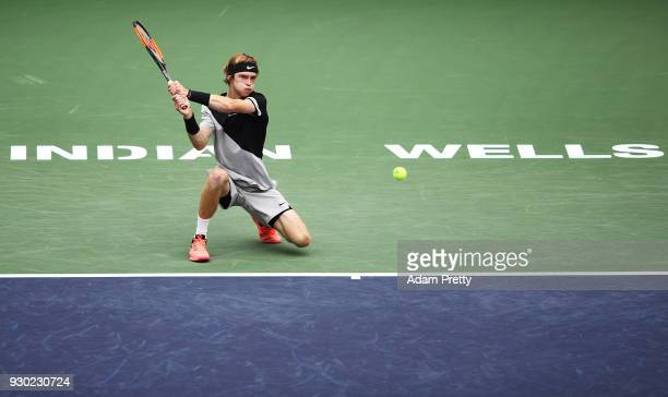 Andrey Rublev of Russia hits a backhand during his match against Taylor Fritz of the USA during the BNP Paribas Open at the Indian Wells Tennis...