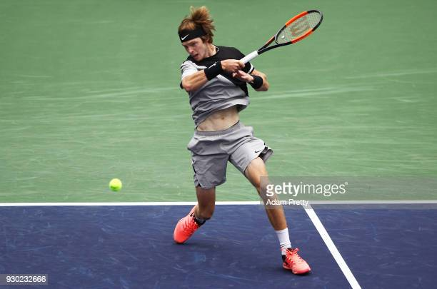 Andrey Rublev of Russia hits a forehand during his match against Taylor Fritz of the USA during the BNP Paribas Open at the Indian Wells Tennis...