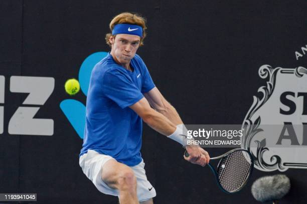 Andrey Rublev of Russia hits a return against Daniel Evans of Britain during their men's quarterfinal singles match at the Adelaide International...