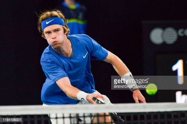 Andrey Rublev of Russia hits a return to Felix AugerAliassime of Canada during their men's semi final singles match at the Adelaide International...
