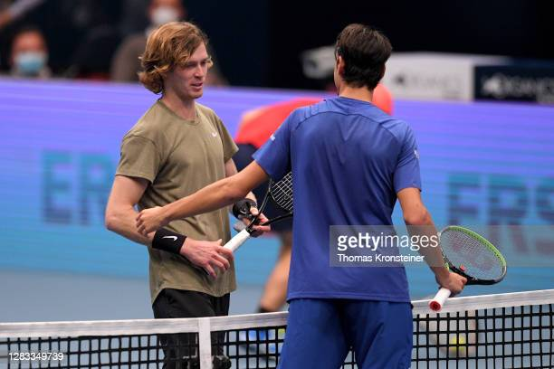 Andrey Rublev of Russia is congratulated by Lorenzo Sonego after their final match on day nine of the Erste Bank Open tennis tournament at Wiener...