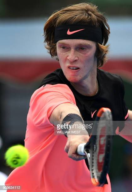 Andrey Rublev of Russia misses a backhand return during his match against Lucas Pouille of France at the Kooyong Classic tennis tournament in...