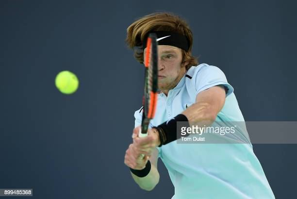 Andrey Rublev of Russia plays a backhand during his 5th place playoff match against Pablo Carreno Busta of Spain on day two of the Mubadala World...