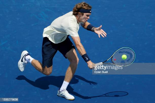 Andrey Rublev of Russia plays a backhand during his match against Benoit Paire of France during Western & Southern Open - Day 6 at the Lindner Family...