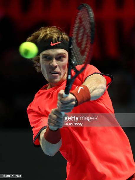 Andrey Rublev of Russia plays a backhand in his match against Taylor Fritz of USA in the group stages during Day One of the Next Gen ATP Finals at...