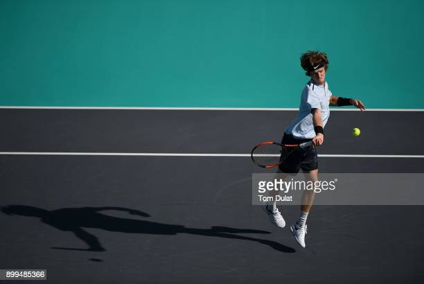 Andrey Rublev of Russia plays a forehand during his 5th place playoff match against Pablo Carreno Busta of Spain on day two of the Mubadala World...