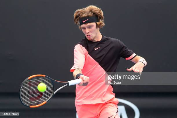 Andrey Rublev of Russia plays a forehand in his first round match against David Ferrer of Spain on day one of the 2018 Australian Open at Melbourne...