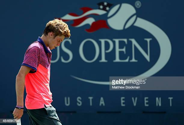 Andrey Rublev of Russia plays against Francis Tiafoe of the United States on Day Twelve of the 2014 US Open at the USTA Billie Jean King National...