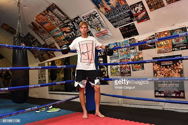 Andrey Rublev of Russia poses at the Fight Club after sparing with boxing trainer George Kolovos during day two of the 2017 Australian Open at...