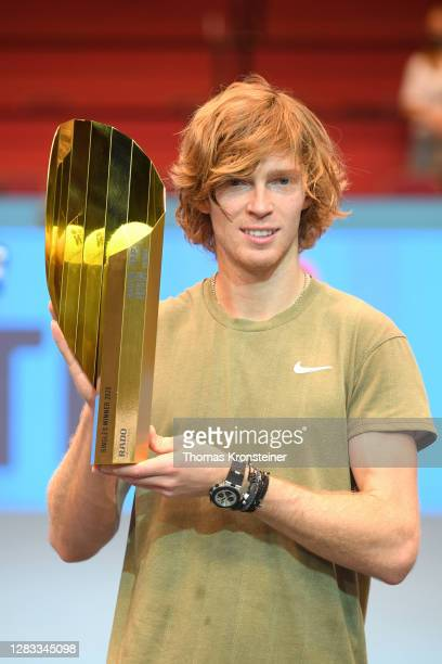 Andrey Rublev of Russia poses with the trophy after winning in his final match against Lorenzo Sonego of Italy on day nine of the Erste Bank Open...