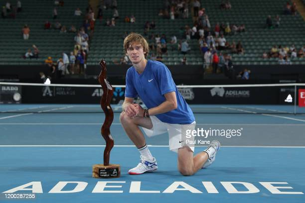Andrey Rublev of Russia poses with the trophy after winning the men's singles grand final against Lloyd Harris of South Africa on day seven of the...