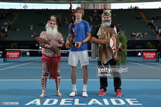 Andrey Rublev of Russia poses with the trophy together with Aboriginal elders Major Sumner and Mickey Kumatpi O'Brien after winning the men's singles...