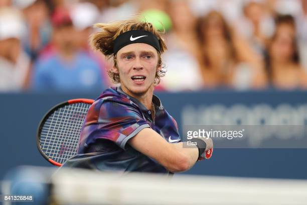 Andrey Rublev of Russia returns a shot against Grigor Dimitrov of Bulgaria during their second round Men's Singles match on Day Four of the 2017 US...