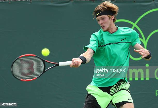 Andrey Rublev of Russia returns a shot against Tomas Berdych of the Czech Republic during day 6 of the Miami Open at Crandon Park Tennis Center on...